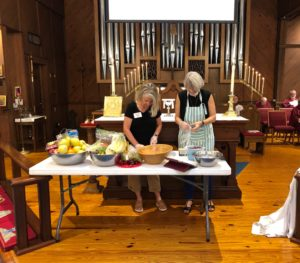 Fruit salad preparation in front of the altar.